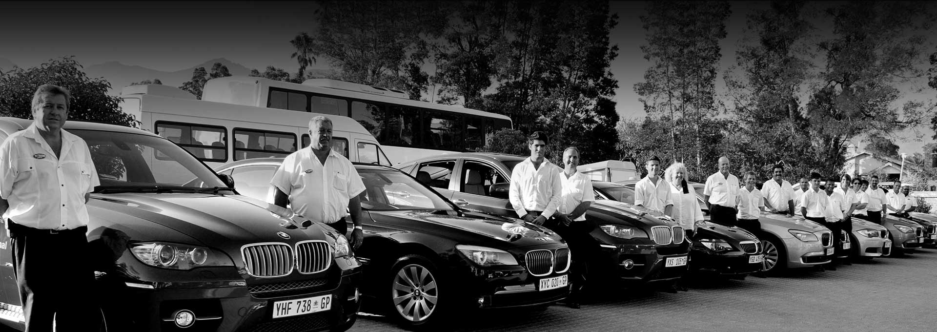 Drivers posing with their BMW's at Fancourt during the BMW Golf Cup International World Final